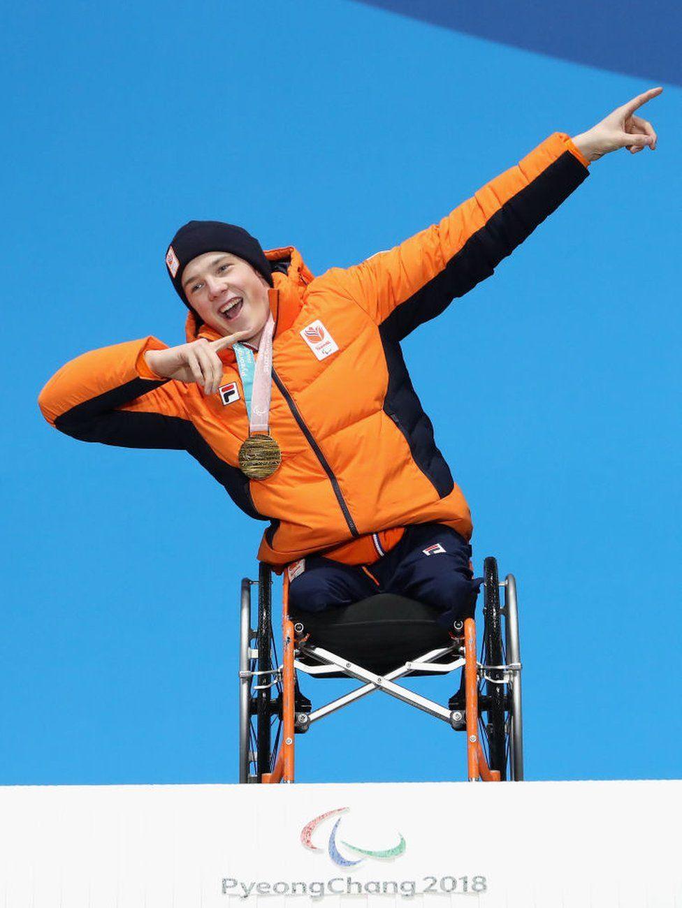 Gold medallist Jeroen Kampschreur poses on the podium after winning a gold medal
