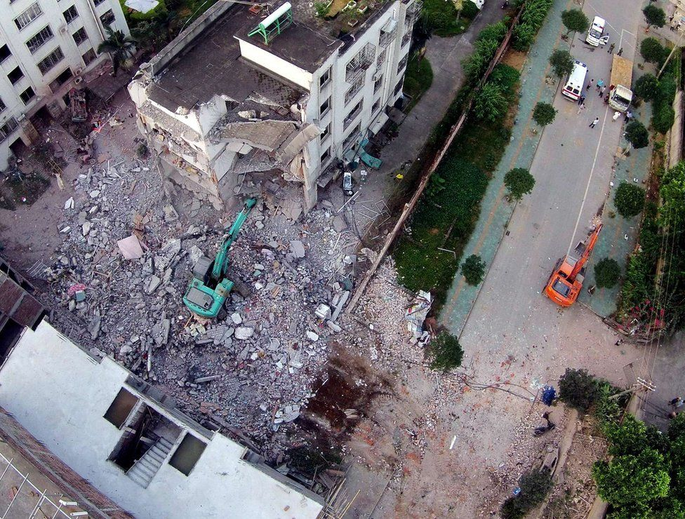 A damaged building is seen a day after a series of blasts in Liucheng county in Liuzhou, south China's Guangxi province on 1 October 2015