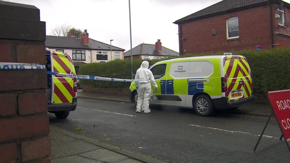 Forensic officers at scene of stabbing