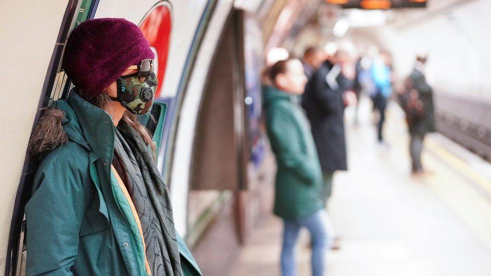 People social distancing on a tube platform