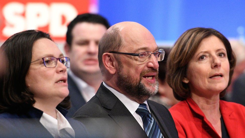 SDP leader Martin Schulz (C) sits next to Andrea Nahles at an SPD conference
