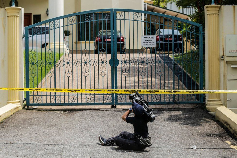 A cameraman films the gates of the North Korean embassy, surrounded by a police cordon, in Kuala Lumpur, Malaysia, 7 March 2017.