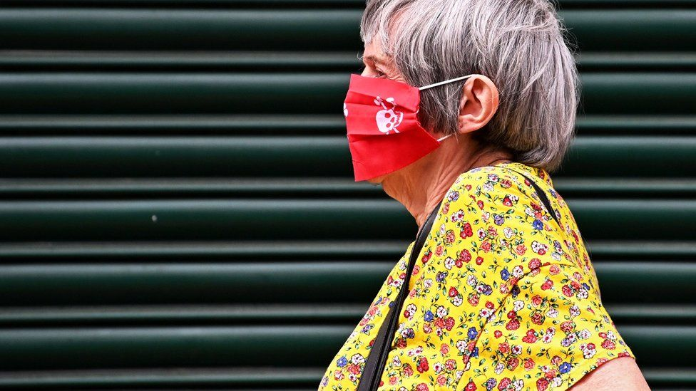 Woman wearing a mask in Leicester
