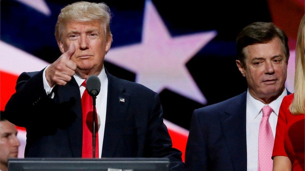 Republican presidential nominee Donald Trump gives a thumbs up as his campaign manager Paul Manafort looks on during Trump's walk through at the Republican National Convention in Cleveland, U.S., July 21, 2016. Picture taken July 21, 2016. REUTERS/Rick Wilking/File Photo/File Photo