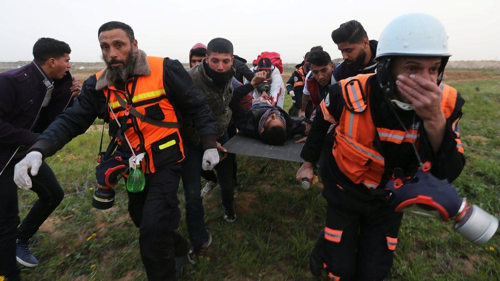 A wounded Palestinian is evacuated during a protest on the Gaza-Israel border fence in the southern Gaza Strip on 15 February 2019