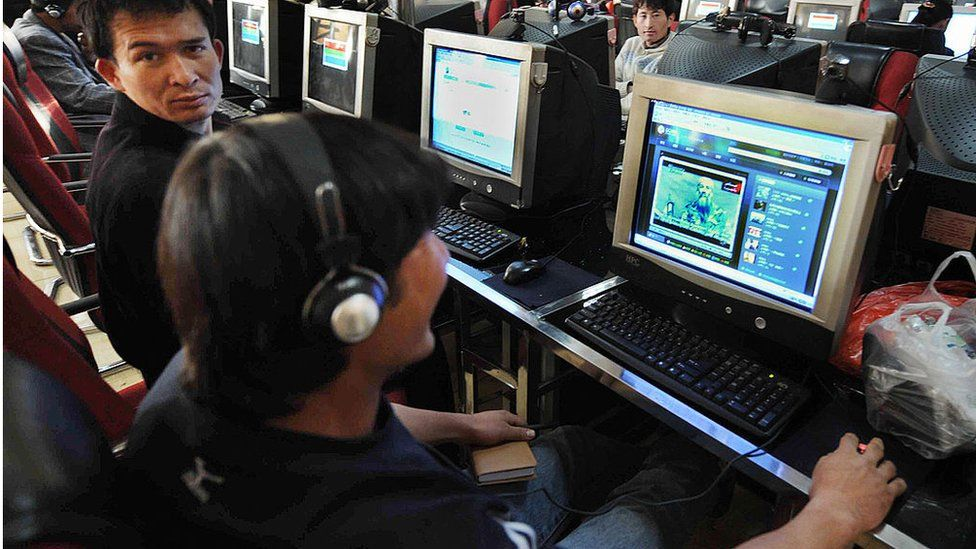 Chinese Muslim Uighurs at an internet cafe in the city of Urumqi in western Xinjiang