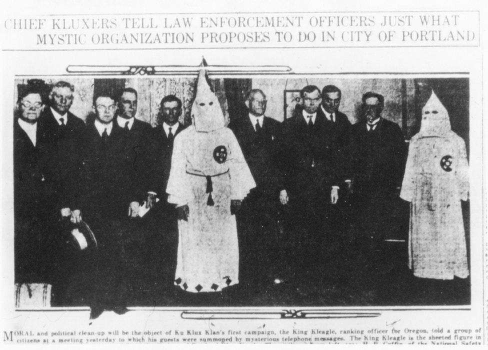Old newspaper photo of KKK chapter leaders with prominent police and local government officials in 1921