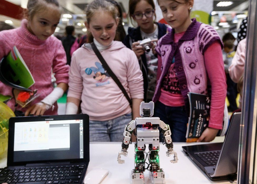Girls at a science fair in Russia