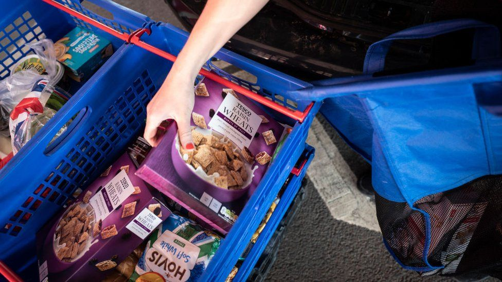 Tesco groceries packed in baskets for delivery