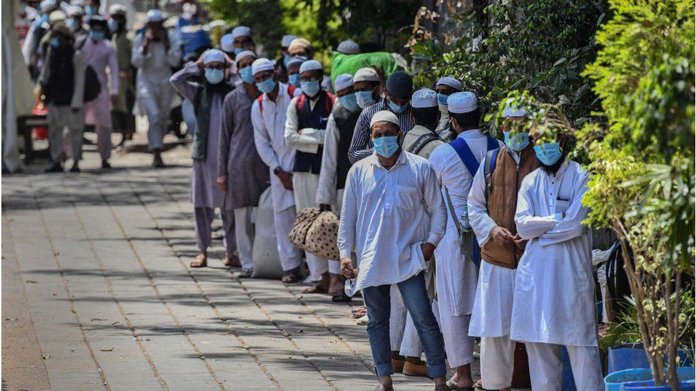People who took part in a Tablighi Jamaat function earlier this month walk to board buses taking them to a quarantine facility amid concerns of infection, on day 7 of the 21 day nationwide lockdown imposed by PM Narendra Modi to check the spread of coronavirus, at Nizamuddin West on March 31, 2020 in New Delhi, India.