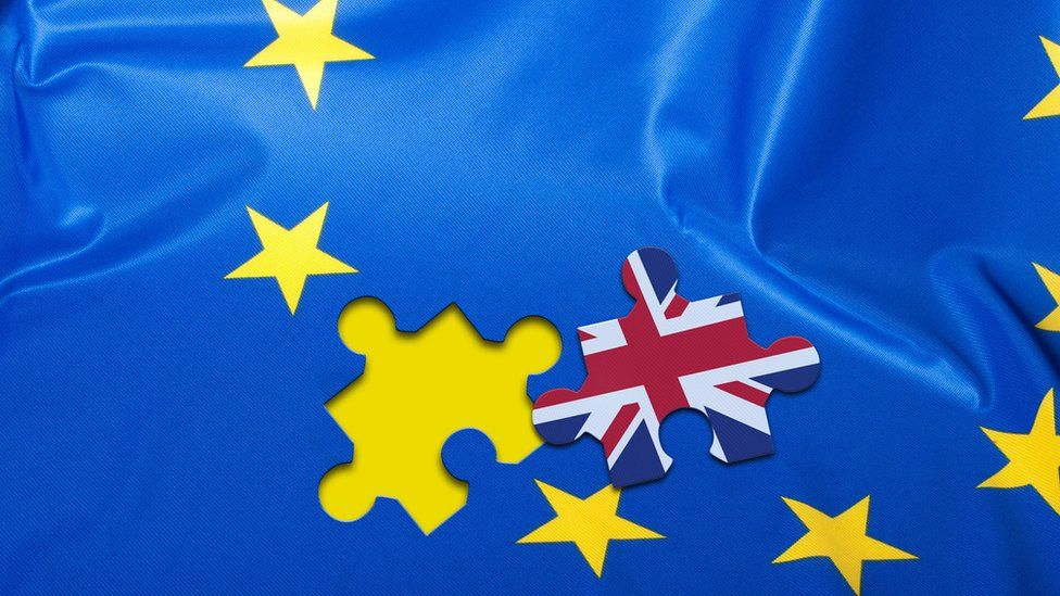 Union flag jigsaw piece on an EU flag