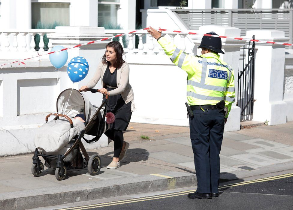Commuters and workers were led outside a police cordon at the scene