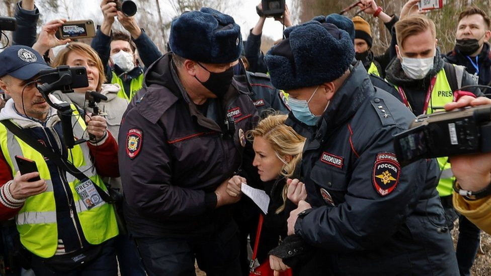 Navalny's personal doctor Anastasia Vasilyeva is held by police outside the prison