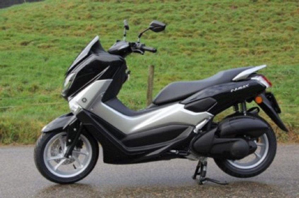 grey coloured Yamaha scooter