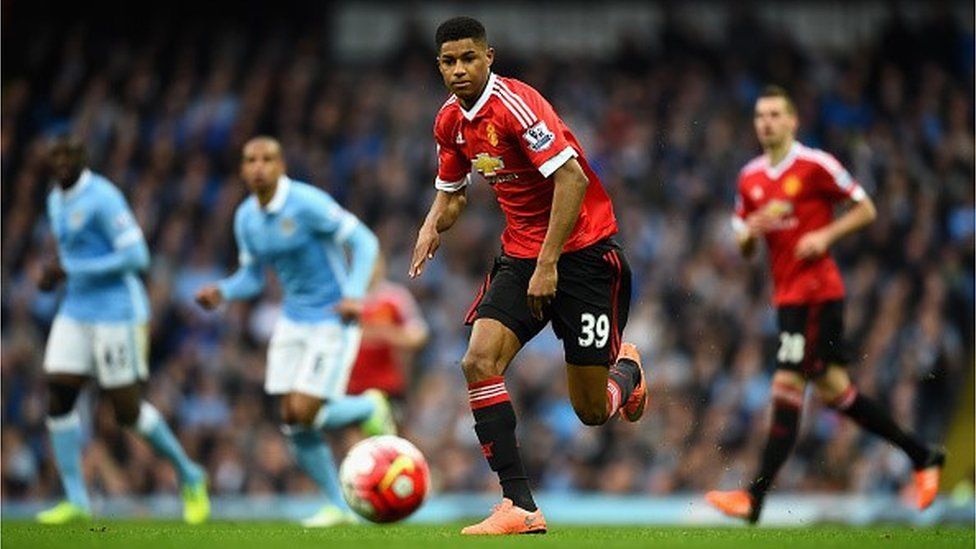 Marcus Rashford of Manchester United in action against Manchester City