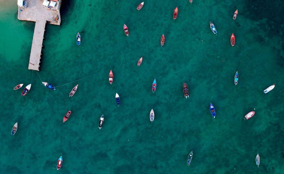 An aerial view of fisher boats in the ocean