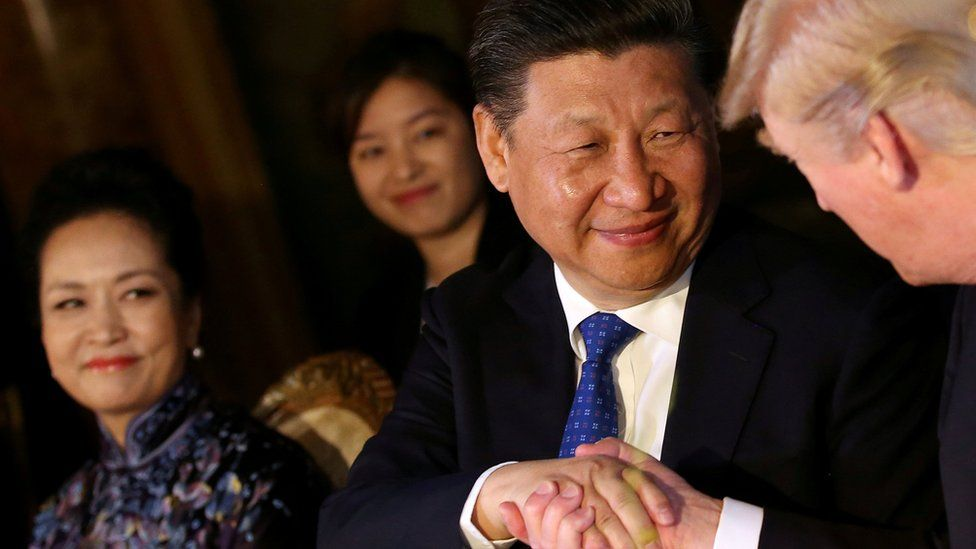 """Chinese President Xi Jinping shakes hands with Donald Trump at the start of a summit at Trump""""s Mar-a-Lago estate in West Palm Beach, Florida, April 6, 2017"""