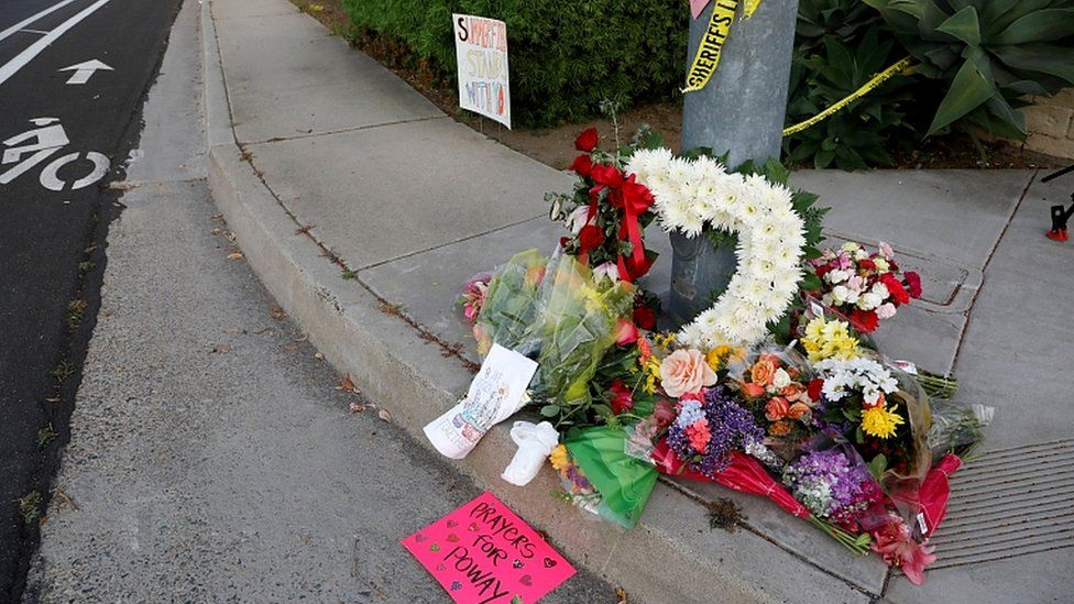 A makeshift memorial near a shooting where one person was killed at the synagogue in Poway, north of San Diego, April 27, 2019