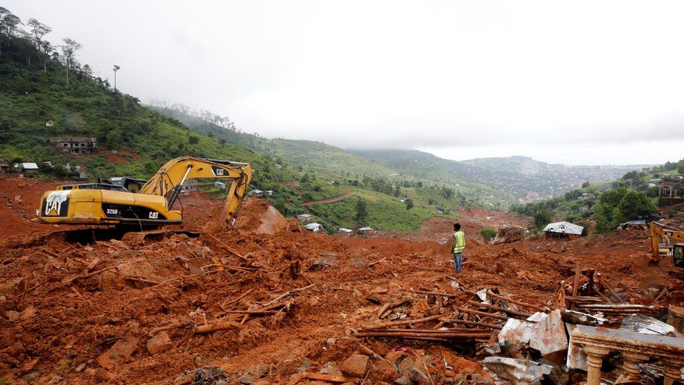 Heavy machines are seen during work at the place of the mudslide in the mountain town of Regent, Sierra Leone August 16, 2017.