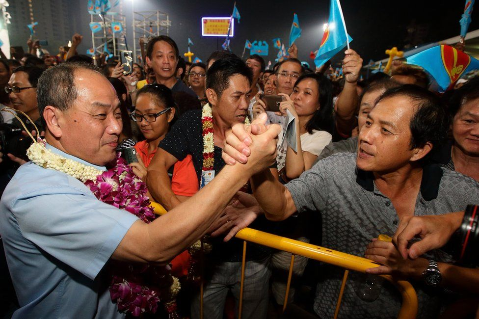 Worker's Party (WP) Secretary General and opposition candidate for the Aljunied Group Representation Constituency (GRC), Low Thia Khiang (L) greets his supporters at the end of his party night rally on the final day of campaigning at Bedok Stadium on 9 September 2015 in Singapore