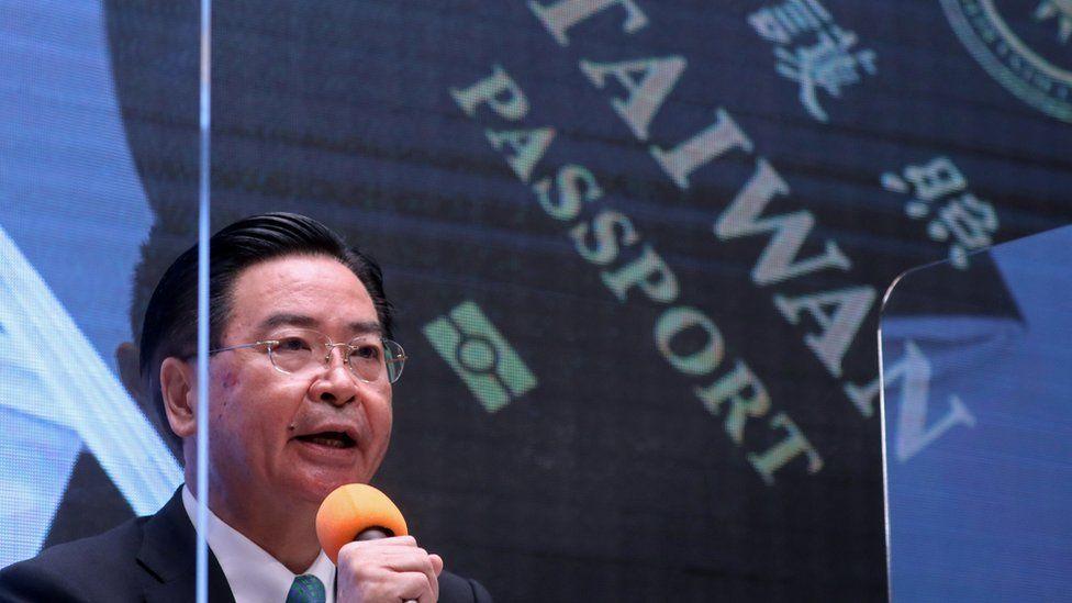 Taiwan Foreign Minister Joseph Wu revealing a new passport design