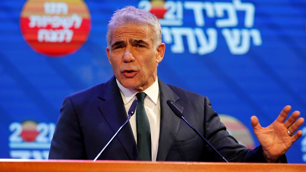 Yesh Atid party leader Yair Lapid delivers a speech in Tel Aviv following the exit polls in Israel's general election