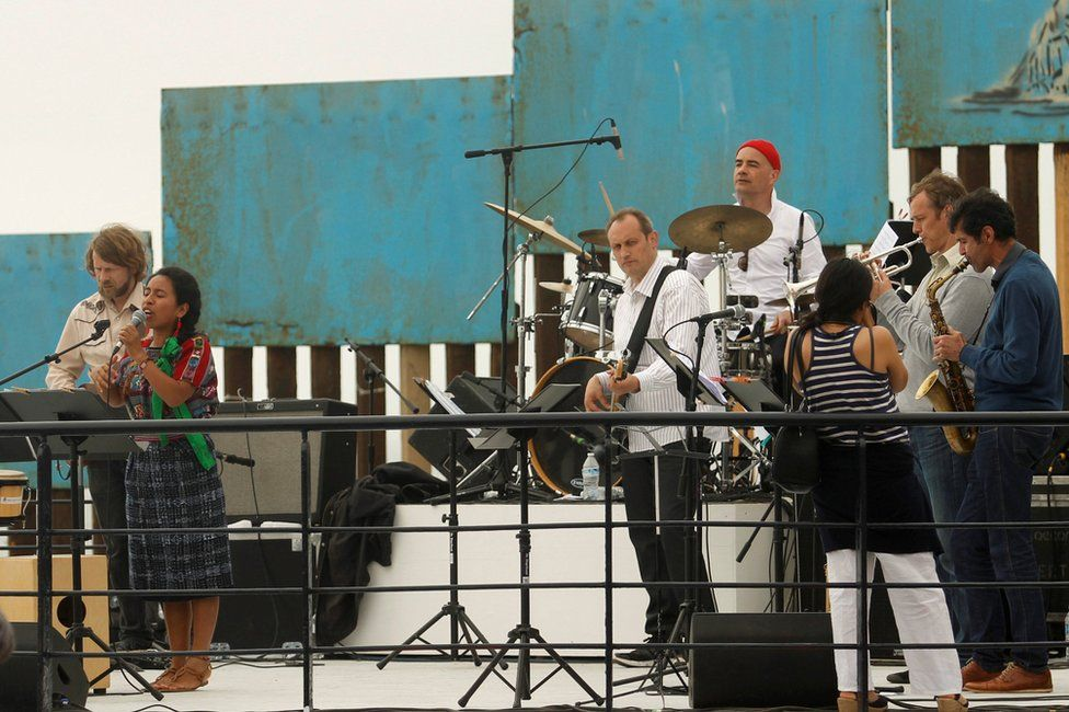 Dresden Symphonic Orchestra and Mexican musicians perform during a Tear Down That Wall concert to protest against Donald Trump's planned wall along the US-Mexican border, in Tijuana, Mexico, 3 June