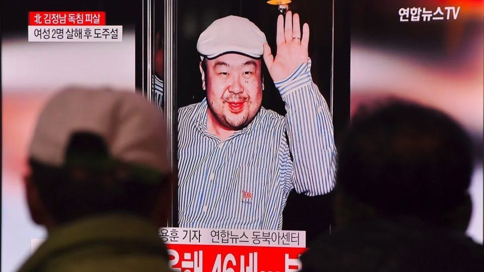 Men watch a TV screen in a train station in Seoul on 14 February 2017 showing an image of Kim Jong-nam.