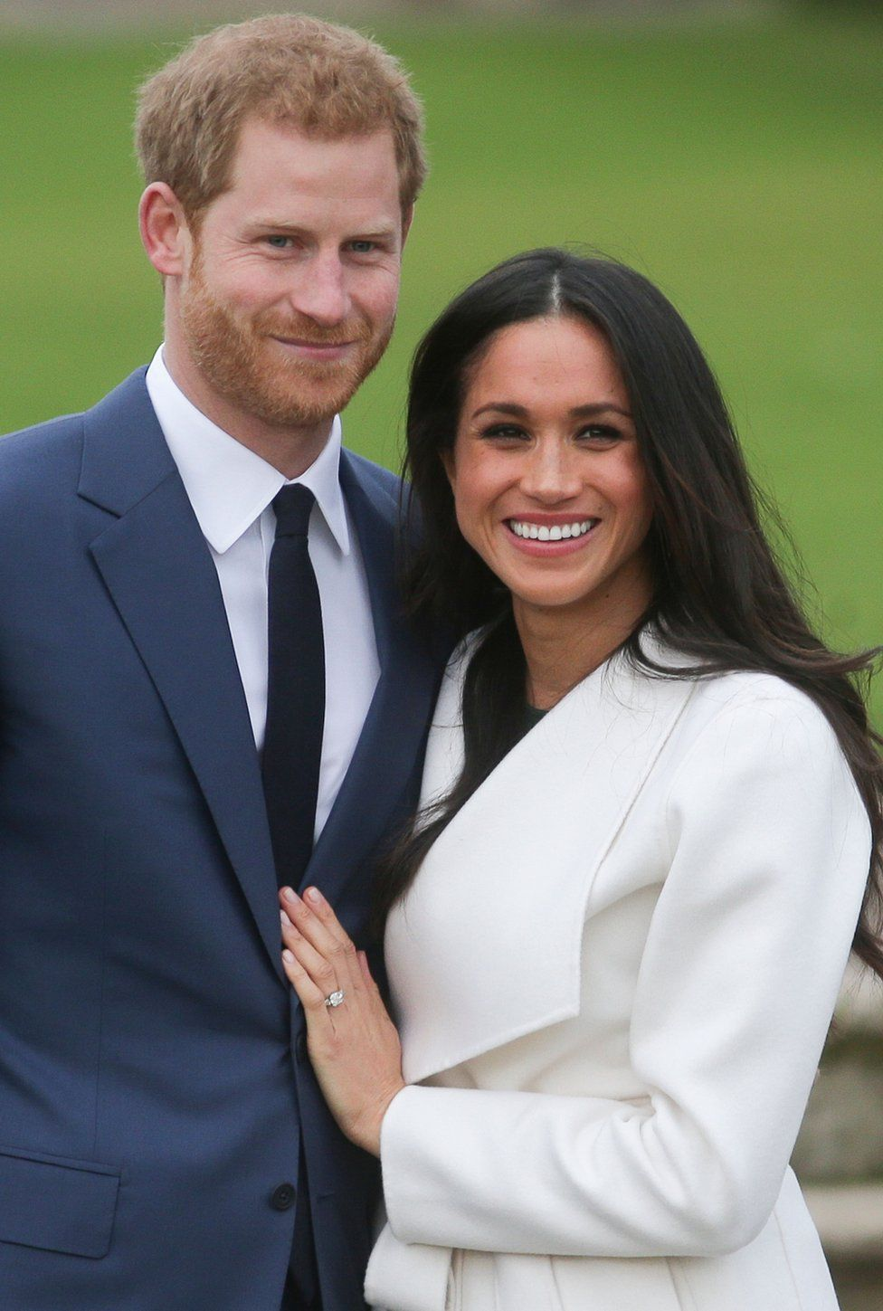 Britain's Prince Harry and his fiance US actress Meghan Markle pose for a photograph in the Sunken Garden at Kensington Palace in west London on 27 November 2017.
