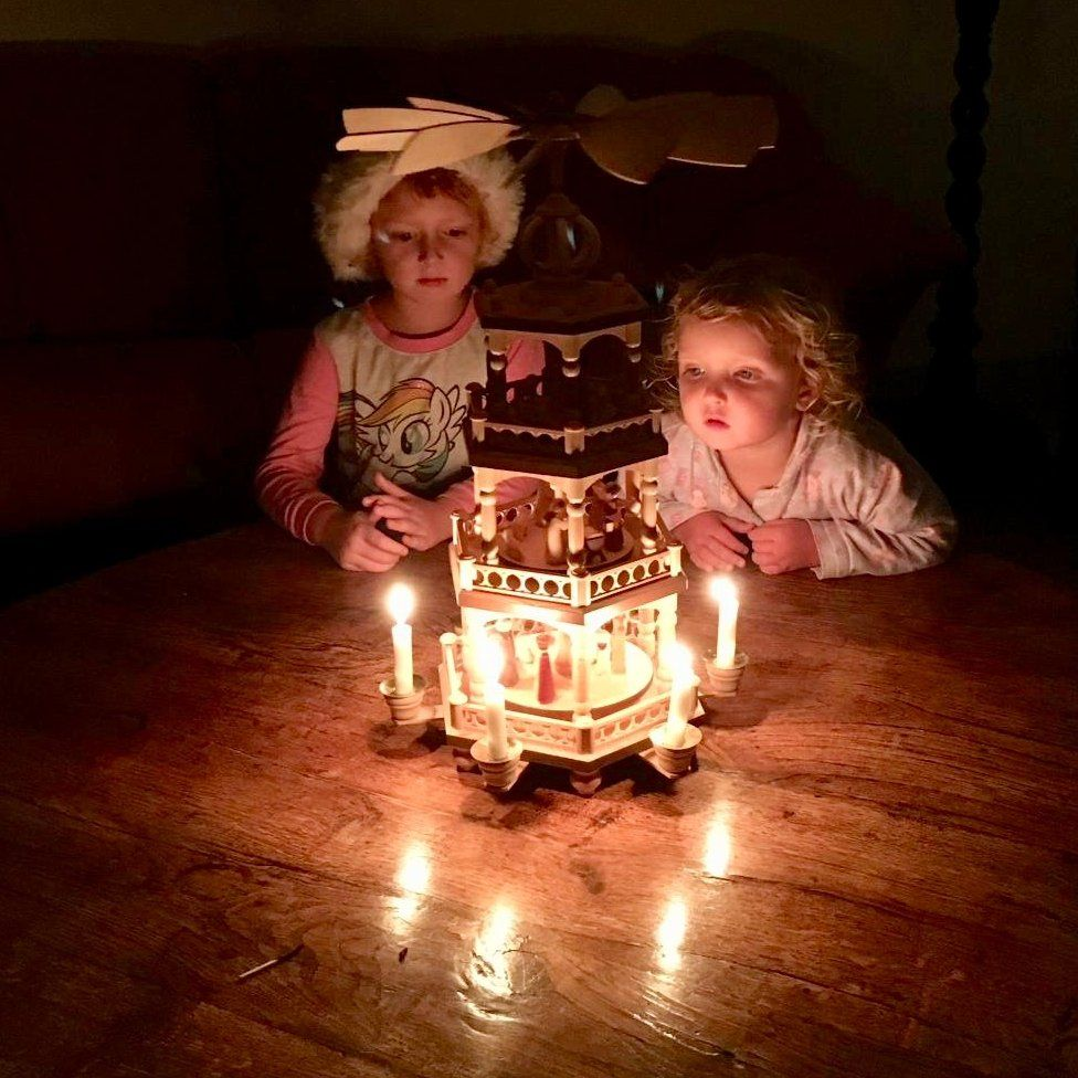 Two girls with a Christmas pyramid