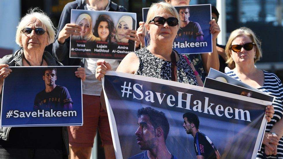 Supporters hold #SaveHakeem posters in Melbourne on 1 February