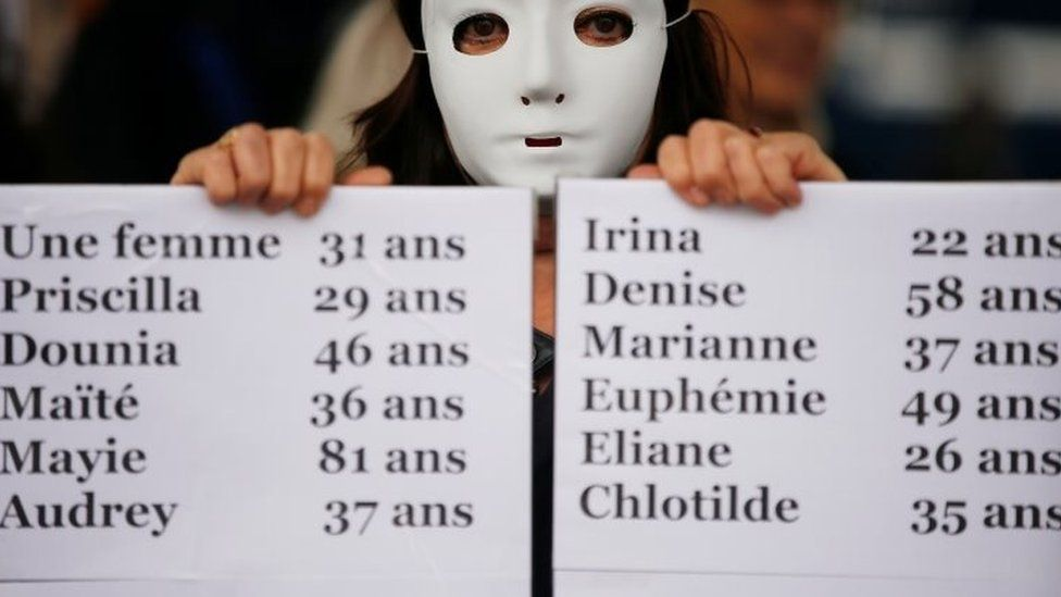 Protesters in Marseille hold placards with the names of some of the victims of domestic violence