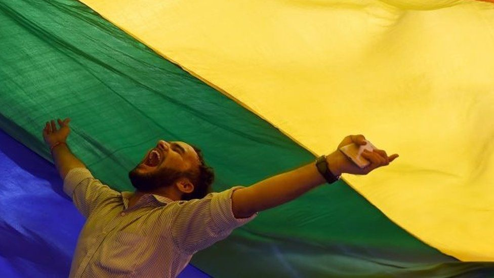 A member of the lesbian, gay, bisexual, transgender (LGBT) community celebrates the Supreme Court decision to strike down a colonial-era ban on gay sex, in Mumbai on September 6, 2018