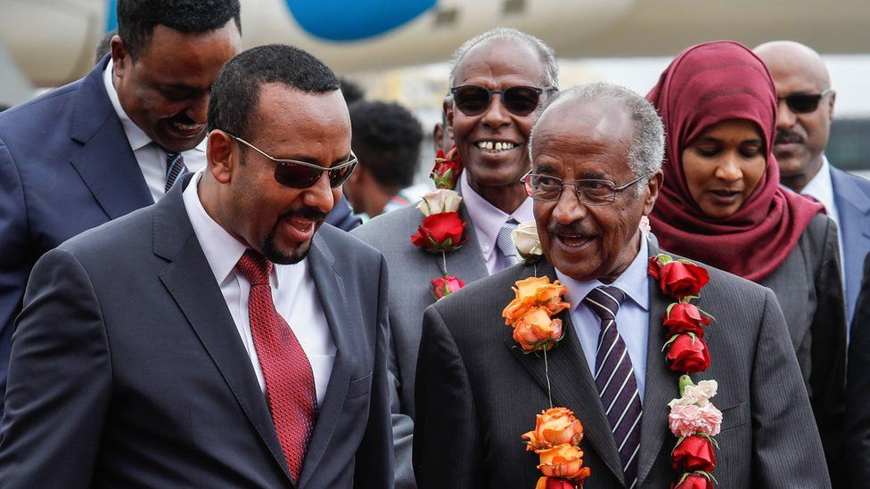 Ethiopia's Prime Minister Abiy Ahmed (L) walks with Eritrea's Foreign minister Osman Saleh Mohammed (R) as Eritrea's delegation arrives for peace talks with Ethiopia at the international airport in Addis Ababa, Ethiopia, on June 26, 2018.