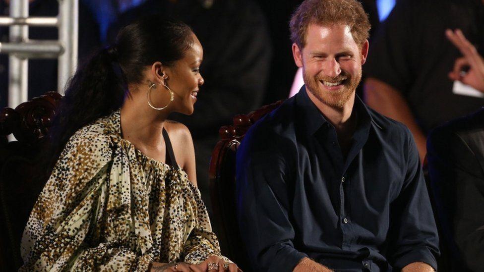 Rihanna and Prince Harry on stage