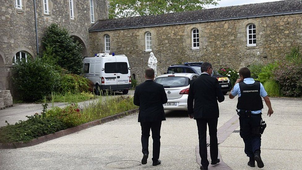 French police walk where a French catholic priest was killed in Saint-Laurent-sur-Sevres