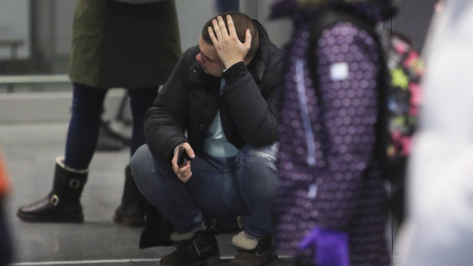 A relative of the crash of Ukraine International Airlines Flight PS752 from Tehran reacts, at Boryspil International Airport in Kiev, Ukraine