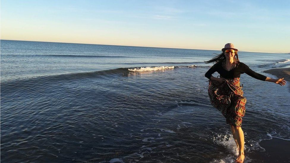 Esther running in the sea