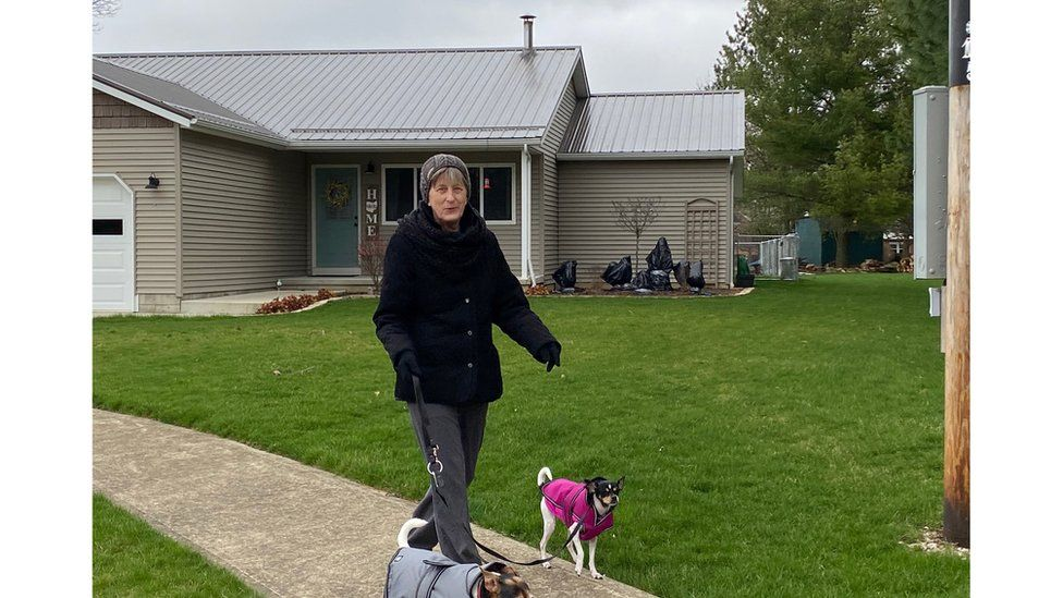 Sheri Thomas walking her dogs