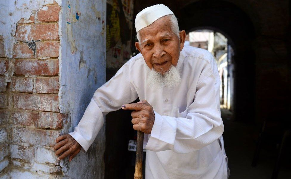 An Indian Muslim voter leaves after casting his vote at a polling station, in Kanpur on April 29, 2019.