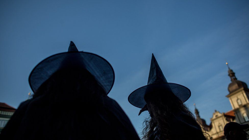 Two women dresses as witches