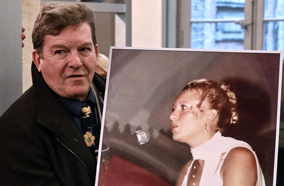 Jacky Kulik, the father of Elodie Kulik who was raped and murdered in 2002, poses with a portrait of his daughter on November 21, 2019 at the courthouse of Amiens