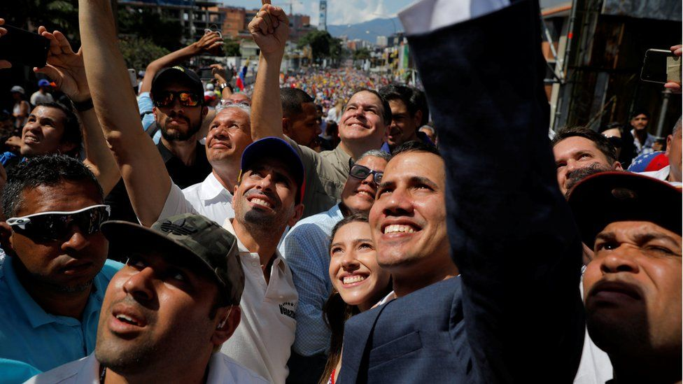 """Venezuelan opposition leader and self-proclaimed interim president Juan Guaido and opposition leader Henrique Capriles attend a rally against Venezuelan President Nicolas Maduro""""s government in Caracas, Venezuela February 2, 2019"""