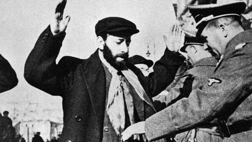 German SS searching Jews in Warsaw, Dec 1939