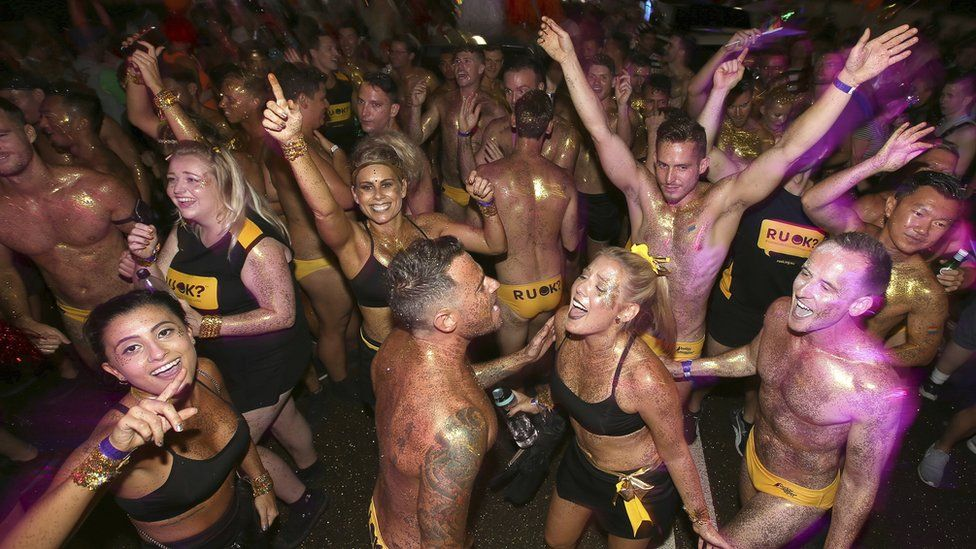 Participants dance before for the annual Gay and Lesbian Mardi Gras parade in Sydney, Saturday, March 4, 2017.