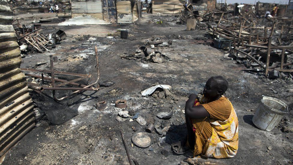 A displaced woman residing in the Protection of Civilians (PoC) site in Malakal, South Sudan, sits in the spot where her shelter used to be on 26 February, 2016.