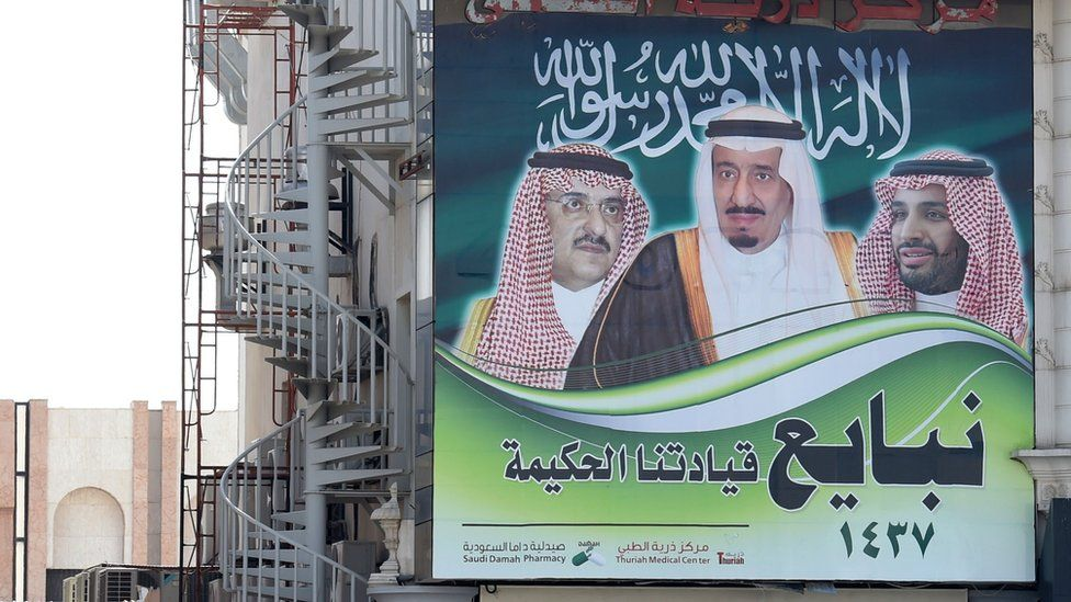 A picture taken on 17 January 2016 in the Saudi capital Riyadh shows a poster on a building showing Saudi King Salman (C), Crown Prince Mohammed Bin Nayef (L) and Deputy Crown Prince Mohammed Bin Salman