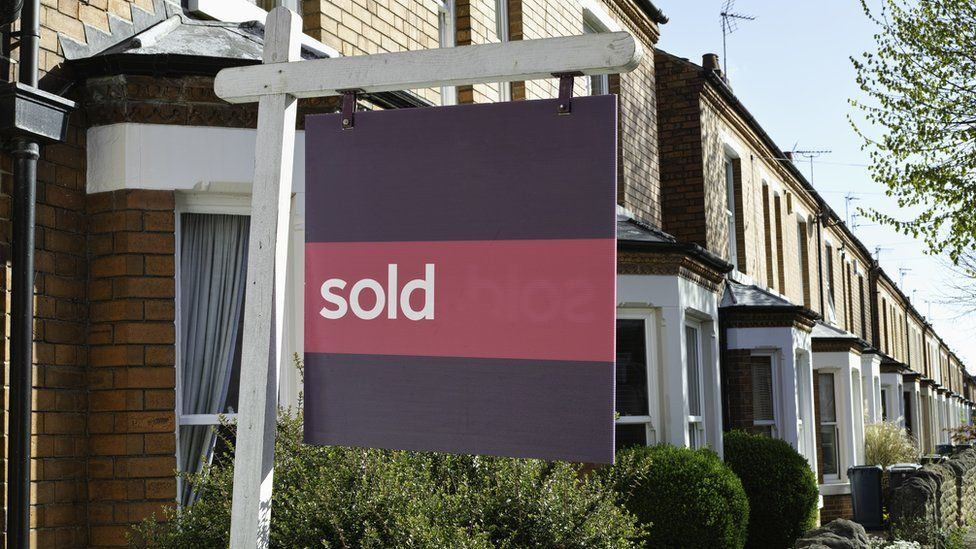 A sold sign outside a house