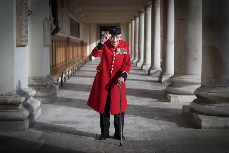 Chelsea Pensioner and D-Day Veteran George Skipper poses for photographs
