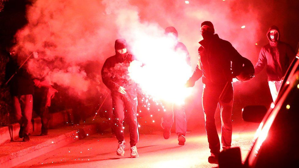 Demonstrators clash with riot police in Nea Smyrni, a southern district of Athens